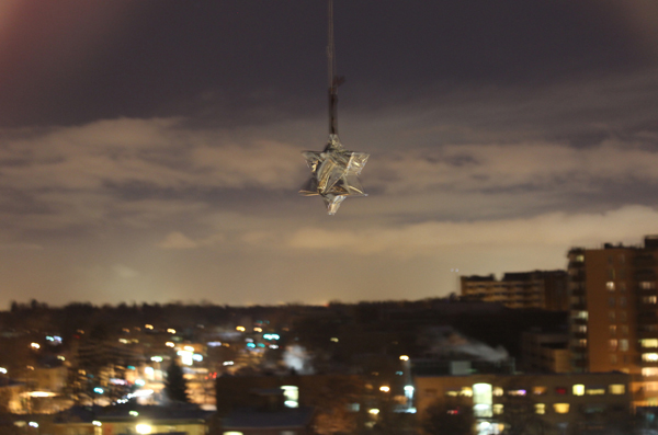 """8.Dec – Jaimie Henthorn, Denver, Colorado, USA  """"The temperature is currently -17 C here. The (reflective) star dangles from the rooftop of our 9-storey building so as to take the photograph from the warmth of our flat. The sky is a public place, yes?"""""""