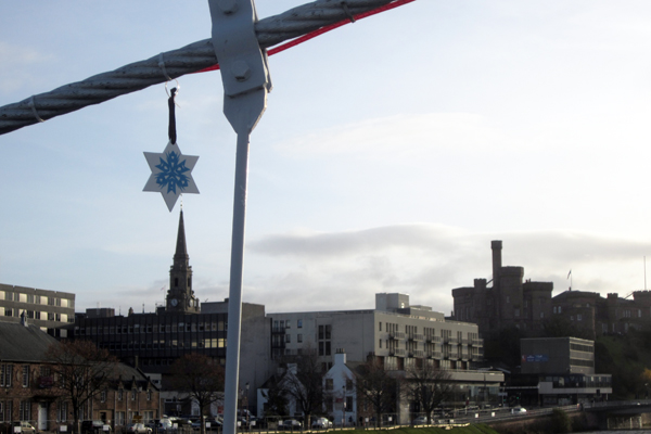 """3. Dec - Emma Chisholm, Inverness """"I hung my star on the wibbly-wobbly bridge in Inverness in view of the castle.  When I was a little girl and we came down to Inverness from Tain I'd always ask my dad to jump on it to make it bounce even more than normal. There are always lots of tourists going over this bridge taking photos of the river and the castle. I thought it would be a good place to put it here so that it would be seen by many and hopefully make them smile."""""""